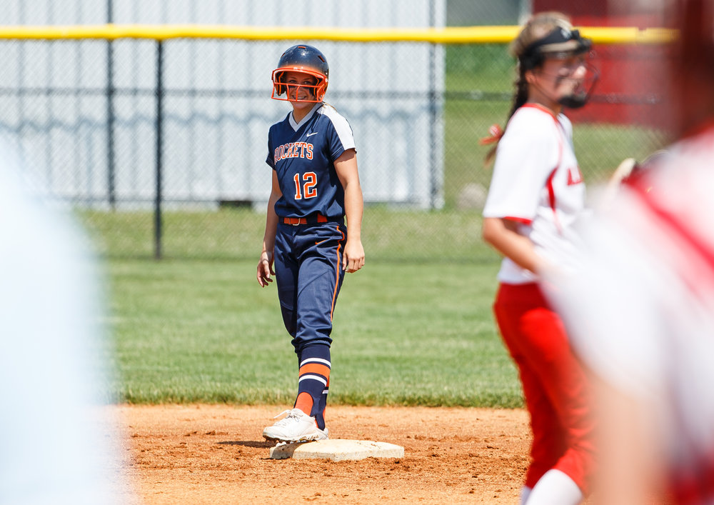 Rochester's Jillian Anderson (12) smiles after a RBI double in the second inning to make it 1-0 Rockets against Glenwood during the Class 3A Glenwood Sectional championship at Glenwood High School, Saturday, June 3, 2017, in Chatham, Ill. [Justin L. Fowler/The State Journal-Register]