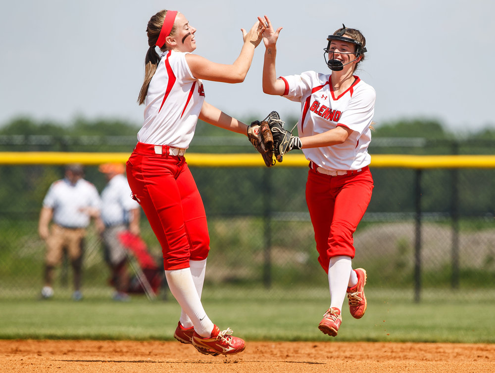 Glenwood's Sarah Bingenheimer (1) and Glenwood's Maddie Wichmann (25) celebrate after the Titans get out of the first inning against Rochester during the Class 3A Glenwood Sectional championship at Glenwood High School, Saturday, June 3, 2017, in Chatham, Ill. [Justin L. Fowler/The State Journal-Register]