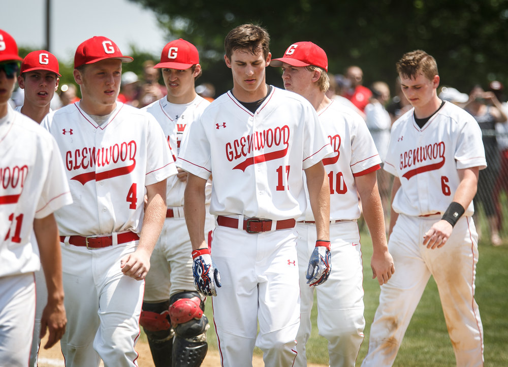Glenwood's Jacob Maton (17) and his teammates walk off the field after being defeating 9-7 by Champaign Central in the Class 3A Glenwood Sectional championship at Chatham Community Park, Saturday, June 3, 2017, in Chatham, Ill. [Justin L. Fowler/The State Journal-Register]