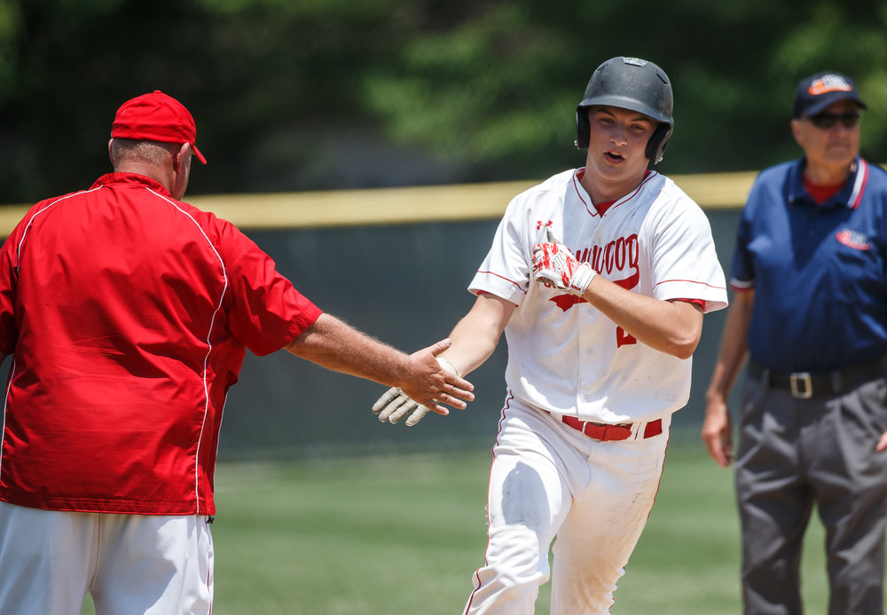 Glenwood's Reid Detmers (28) gets the high five from Glenwood baseball head coach Pat Moomey after a two-run home run against Champaign Central in the fifth inning during the Class 3A Glenwood Sectional championship at Chatham Community Park, Saturday, June 3, 2017, in Chatham, Ill. [Justin L. Fowler/The State Journal-Register]