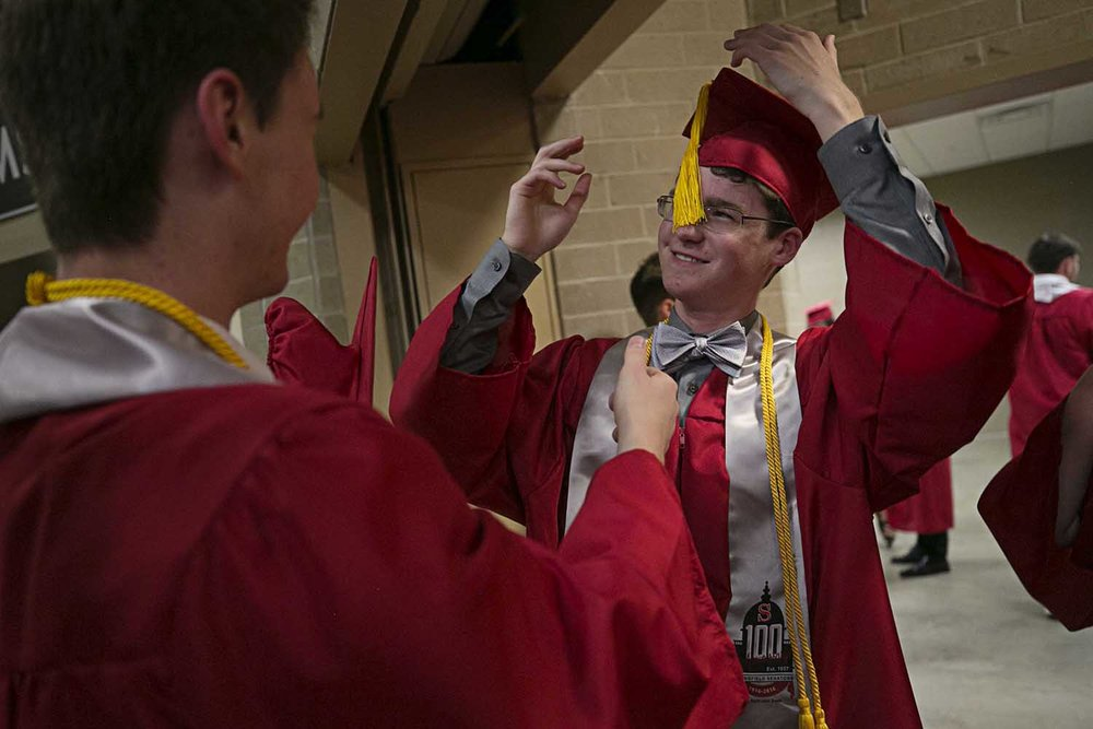 Sean Burke wrestles with his tassel before the Springfield High School graduation at the Bank of Springfield Center Saturday June 3, 2017 [Photo by Jason Johnson]