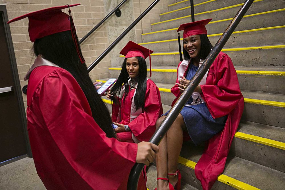 From left Dalona Womack, Shontavia McDaniel and Danaja Robinson rest for a minute in the stairwell before the Springfield High School graduation at the Bank of Springfield Center Saturday June 3, 2017 [Photo by Jason Johnson]