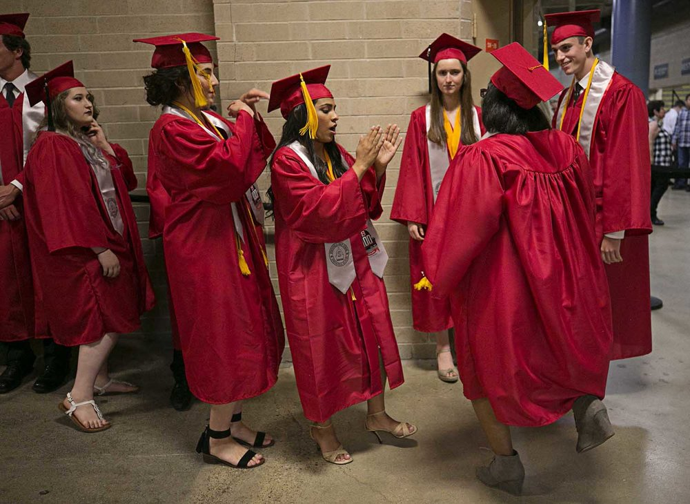 Valedictorian Alina Sinha dances with classmates before the the Springfield High School graduation at the Bank of Springfield Center Saturday June 3, 2017 [Photo by Jason Johnson]
