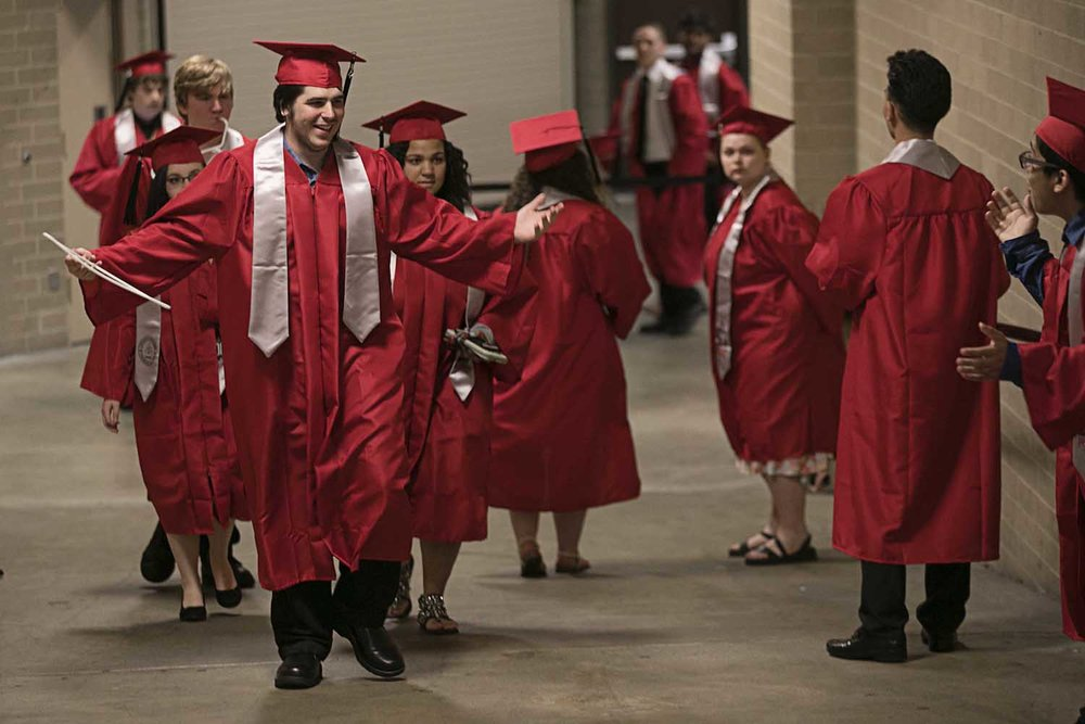 Luke Walsh walks up the ramp to meet fellow classmates before the Springfield High School graduation at the Bank of Springfield Center Saturday June 3, 2017 [Photo by Jason Johnson]
