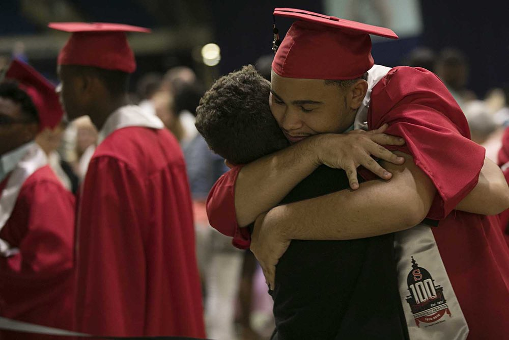 Elijah Phillips embraces little brother Noah Phillips before the Springfield High School graduation at the Bank of Springfield Center Saturday June 3, 2017 [Photo by Jason Johnson]
