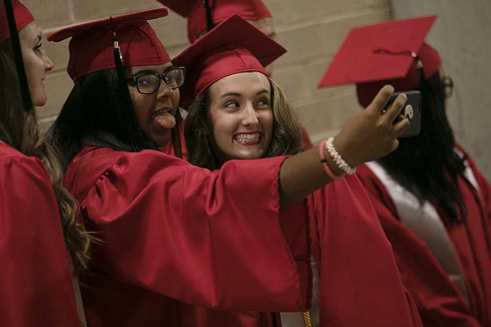 Jailynn Brown at left and Alexys Bergschneider take a selfie together before the Springfield High School graduation at the Bank of Springfield Center Saturday June 3, 2017 [Photo by Jason Johnson]