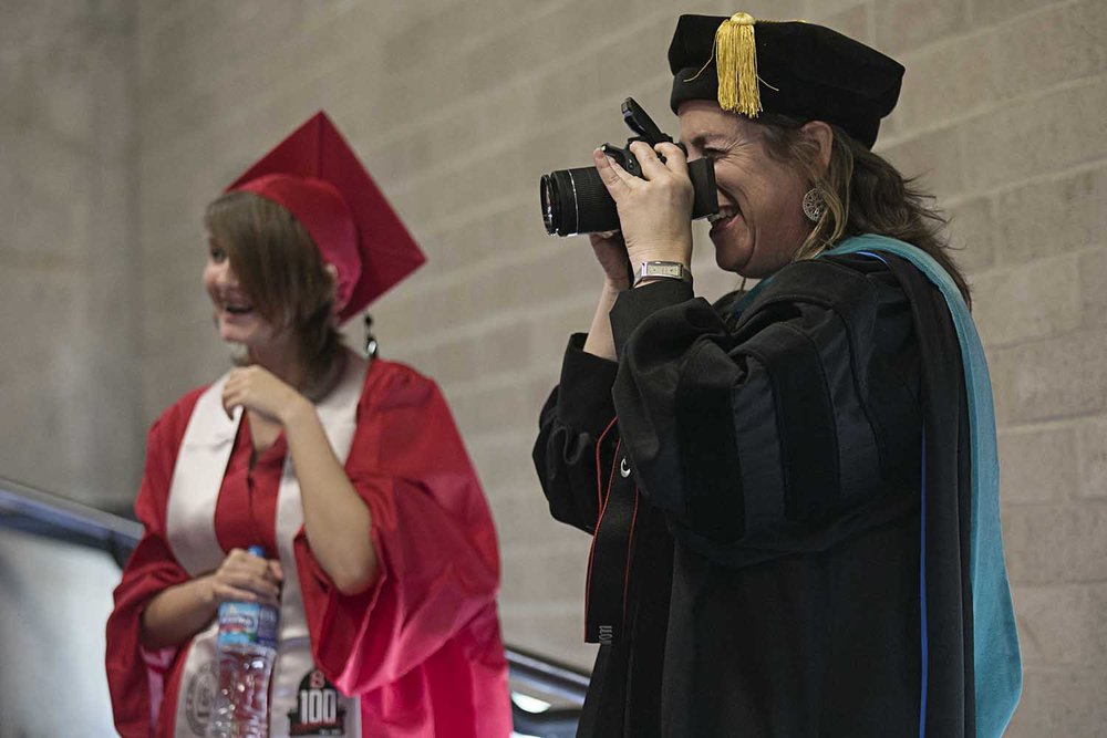 Springfield High School Principal Lisa Leardi snaps pictures of her students before the Springfield High School graduation at the Bank of Springfield Center Saturday June 3, 2017 [Photo by Jason Johnson]