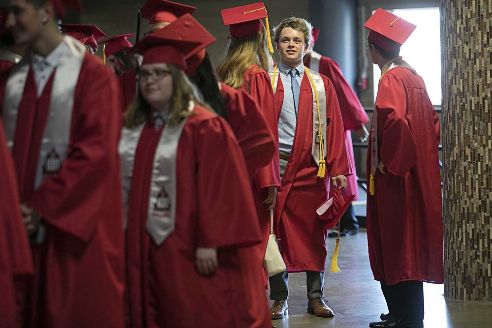 Evan Weller waits with his classmates before the procession of the 100th graduating class of Springfield High School at the Bank of Springfield Center Saturday June 3, 2017 [Photo by Jason Johnson]