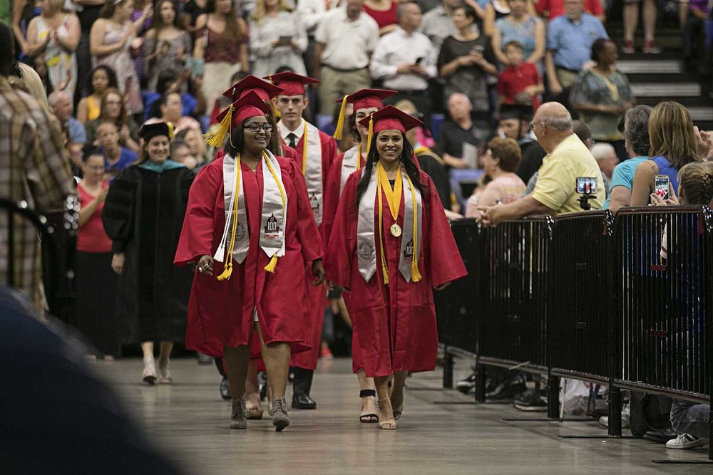 Class president A'Maginese O'Neal at left and valedictorian Alina Sinha walk into the Bank of Springfield Center during the Springfield High School graduation Saturday June 3, 2017 [Photo by Jason Johnson]