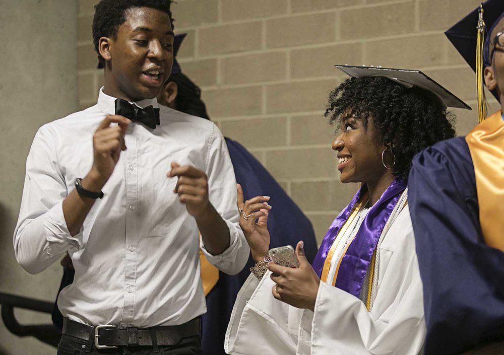 Wanton Gage at left practices a poem with Mariah Brooks before they perform during the Springfield Southeast High School graduation at the Bank of Springfield Center Saturday June 3, 2017 [Photo by Jason Johnson]