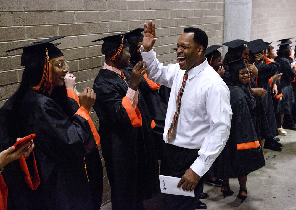 Artie Doss, Lanphier High principal, had a fist bump, high five or hug for every one of the graduating class before Lanphier's graduation at the Bank of Springfield Center Saturday, June 3, 2017. [Rich Saal/The State Journal-Register]