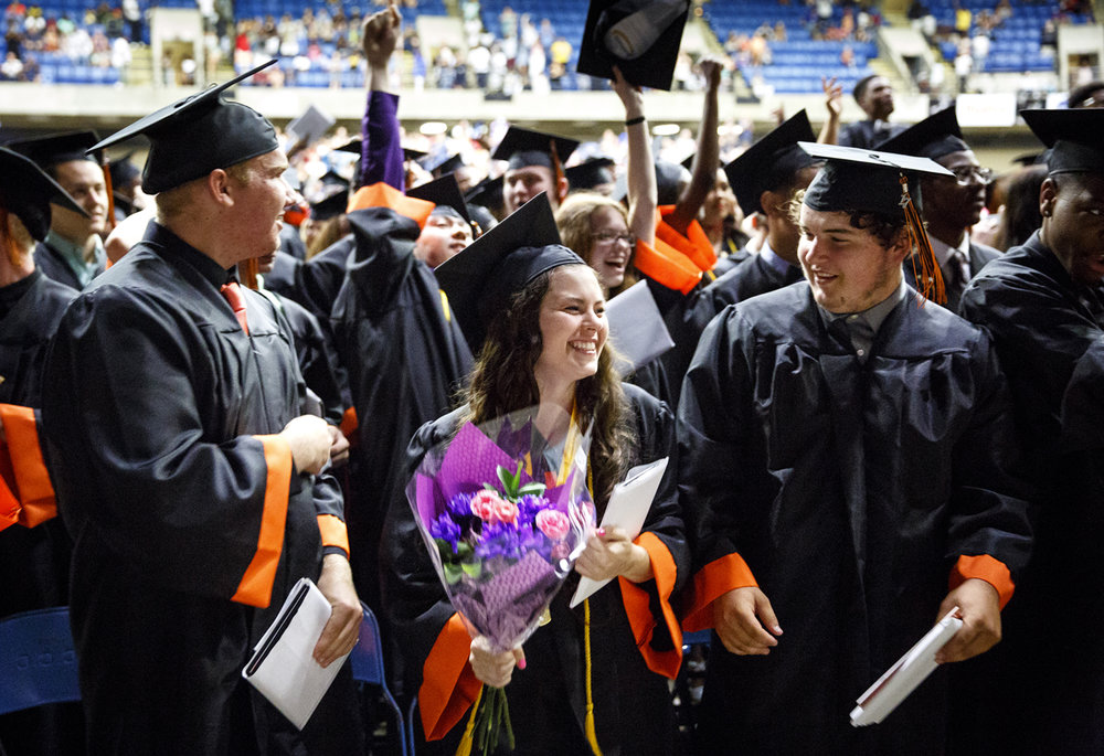 Lanphier High School valedictorian Dominique LaSalvia, center, and classmates celebrate after being declared graduates at the Bank of Springfield Center Saturday, June 3, 2017. [Rich Saal/The State Journal-Register]