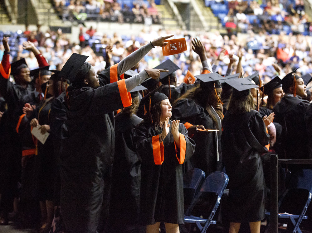 Lanphier High School graduates salute their parents, guardians or mentors during their graduation at the Bank of Springfield Center Saturday, June 3, 2017. [Rich Saal/The State Journal-Register]