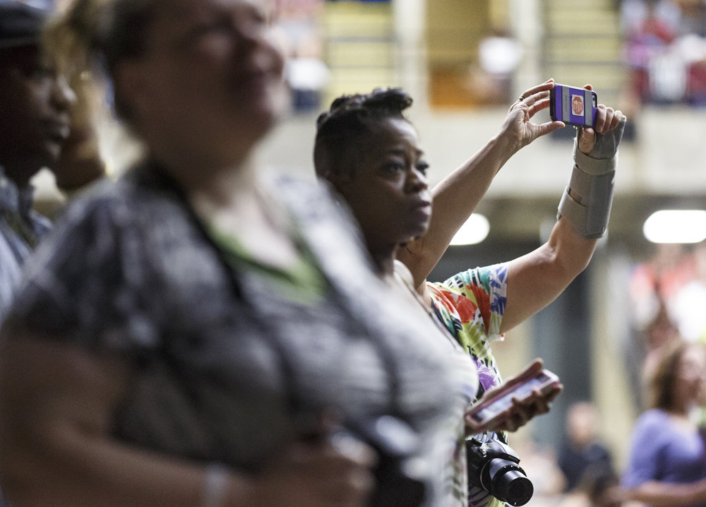 Relatives reach out to take pictures at the Lanphier High School graduation at the Bank of Springfield Center Saturday, June 3, 2017. [Rich Saal/The State Journal-Register]
