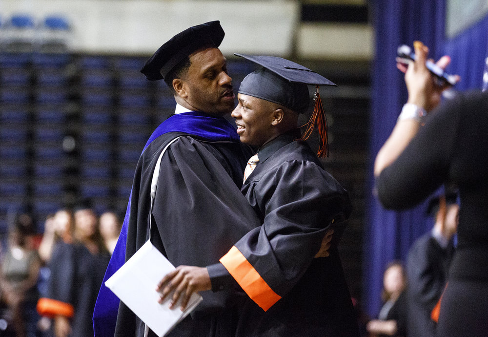 Yakeema Rose is greeted by Lanphier High principal Artie Doss during Lanphier's graduation at the Bank of Springfield Center Saturday, June 3, 2017. [Rich Saal/The State Journal-Register]