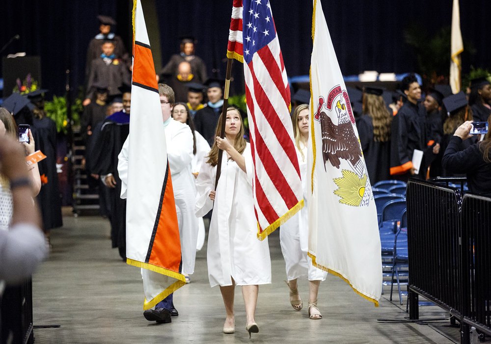 Representatives of the Class of 2018 served as processional attendants and flag bearers during the Lanphier High School graduation at the Bank of Springfield Center Saturday, June 3, 2017. [Rich Saal/The State Journal-Register]