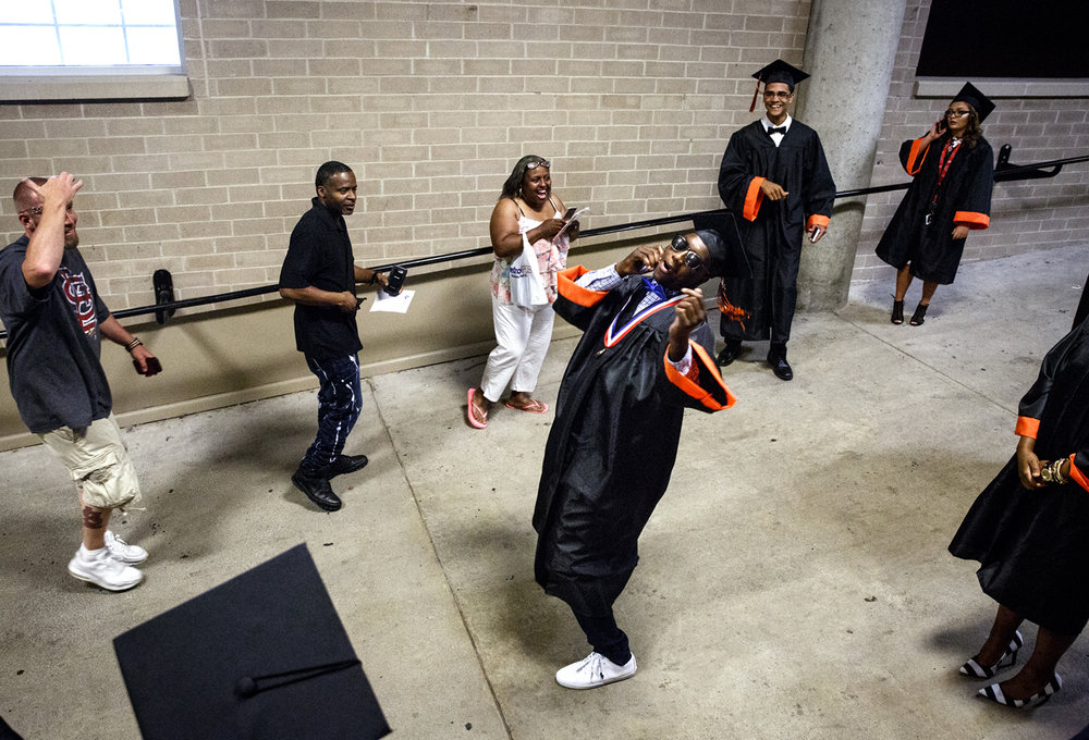 Corrington Jones breaks into dance in the hallway where graduates were lined up before the Lanphier High School graduation at the Bank of Springfield Center Saturday, June 3, 2017. [Rich Saal/The State Journal-Register]