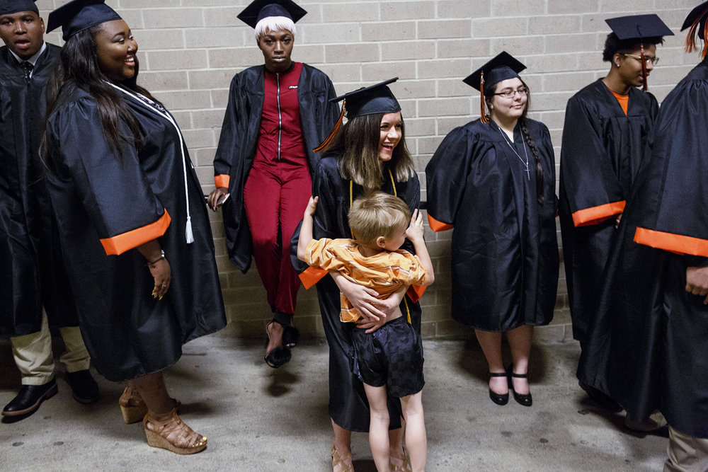 Jalee Braner got a hug from her brother, John, before the Lanphier High School graduation at the Bank of Springfield Center Saturday, June 3, 2017. [Rich Saal/The State Journal-Register]