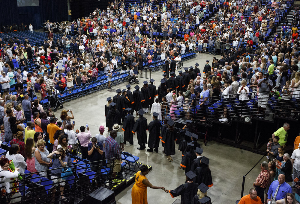The graduating class of Lanphier High School processes into the Bank of Springfield Center Saturday, June 3, 2017. [Rich Saal/The State Journal-Register]