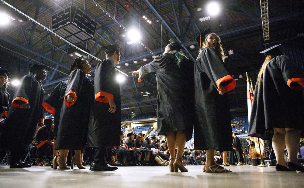 Graduating seniors line up before walking across the stage to receive their diplomas at the Lanphier High School graduation at the Bank of Springfield Center Saturday, June 3, 2017. [Rich Saal/The State Journal-Register]