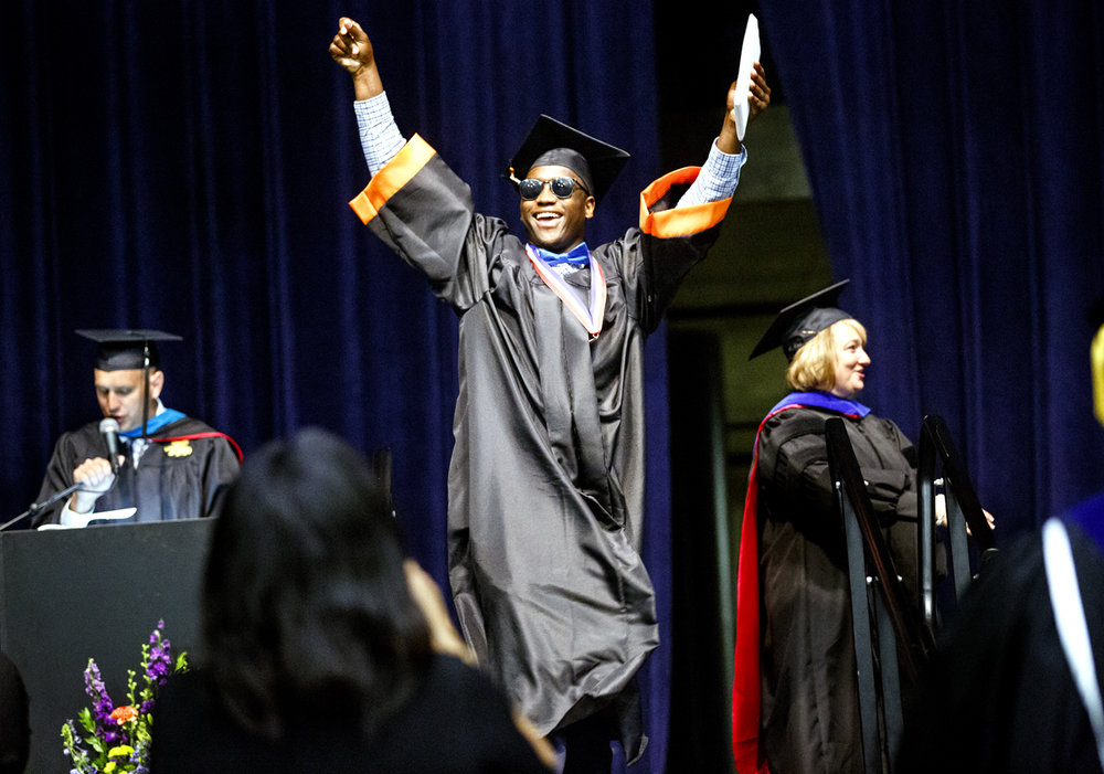 Corrington Jones celebrates after receiving his diploma at the Lanphier High School graduation at the Bank of Springfield Center Saturday, June 3, 2017. [Rich Saal/The State Journal-Register]