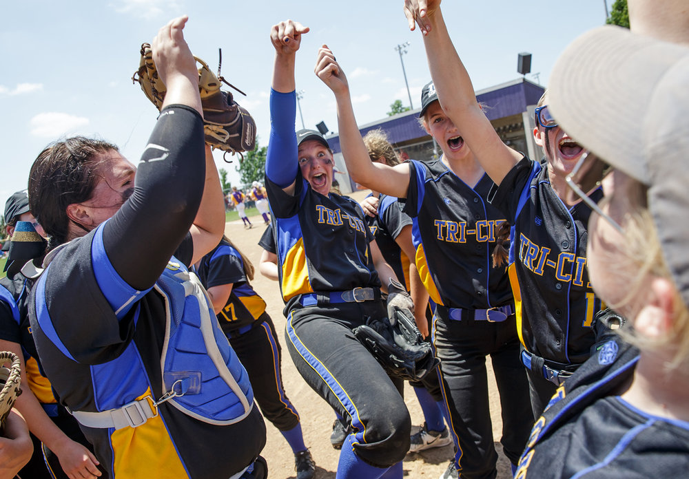 Tri-City's Aubrey Hunt (4) celebrates with her teammates after they defeated Williamsville 4-3 in the Class 2A Williamsville Sectional Championship game at Jane Grebner Field, Saturday, May 27, 2017, in Williamsville, Ill. [Justin L. Fowler/The State Journal-Register]