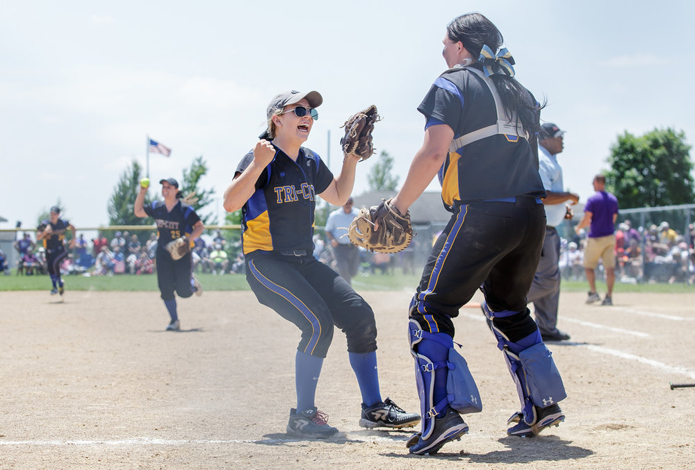 Tri-City's Payton Sturdy (21) leaps into the arms of Tri-City's Katie Jarrett (5) after Tri-City defeated Williamsville 4-3 in the Class 2A Williamsville Sectional Championship game at Jane Grebner Field, Saturday, May 27, 2017, in Williamsville, Ill. [Justin L. Fowler/The State Journal-Register]