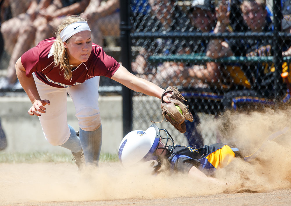 Tri-City's Catherine Bocek (31) avoids the tag from St. Joseph Ogden's Andrea Coursey (6) as she slides safely into third base in the third inning during the Class 2A Athens Supersectional at Athens High School, Monday, May 29, 2017, in Athens, Ill. [Justin L. Fowler/The State Journal-Register]