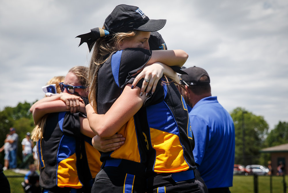 Tri-City's Shayla Mills (9) hugs Tri-City's Hailey Patrick (23) after the Tornadoes were defeated 9-5 by St. Joseph Ogden during the Class 2A Athens Supersectional at Athens High School, Monday, May 29, 2017, in Athens, Ill. [Justin L. Fowler/The State Journal-Register]