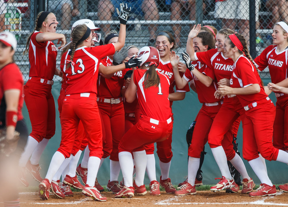 Glenwood's Sarah Bingenheimer (1) is swarmed by her teammates after a two-run home run to put the Titans up 3-2 against Mt. Zion in the third inning during the Class 3A Glenwood Sectional semifinals at Glenwood High School, Tuesday, May 30, 2017, in Chatham, Ill. [Justin L. Fowler/The State Journal-Register]