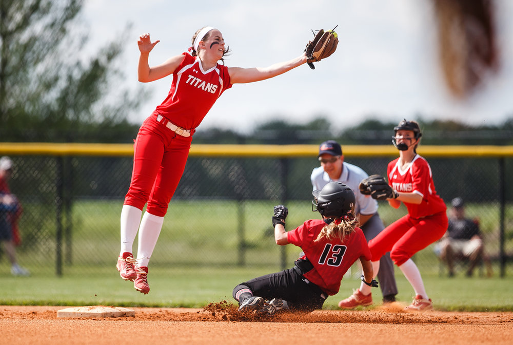 Glenwood's Sarah Bingenheimer (1) snags the throw to second out of the air as Mt. Zion's Delaney Sarff (13) steals second base in the first inning during the Class 3A Glenwood Sectional semifinals at Glenwood High School, Tuesday, May 30, 2017, in Chatham, Ill. [Justin L. Fowler/The State Journal-Register]