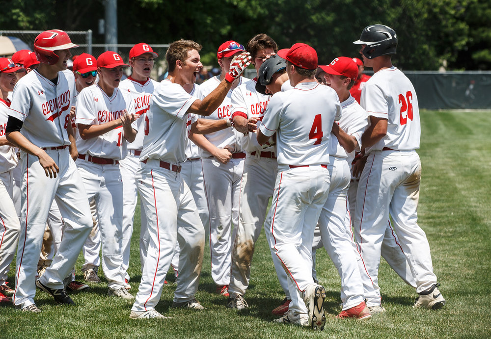 Glenwood's Reid Detmers (28) is swarmed by his teammates after hitting a two-run home run against Champaign Central giving the Titans a 6-3 lead in the fifth inning during the Class 3A Glenwood Sectional championship at Chatham Community Park, Saturday, June 3, 2017, in Chatham, Ill. [Justin L. Fowler/The State Journal-Register]