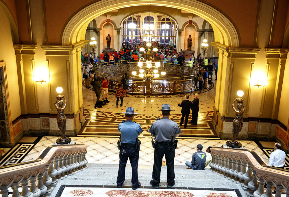 Secretary of State Police watch  the March to Springfield protest and rally at the Capitol in Springfield, Ill. Tuesday, May 30, 2017. [Rich Saal/The State Journal-Register]