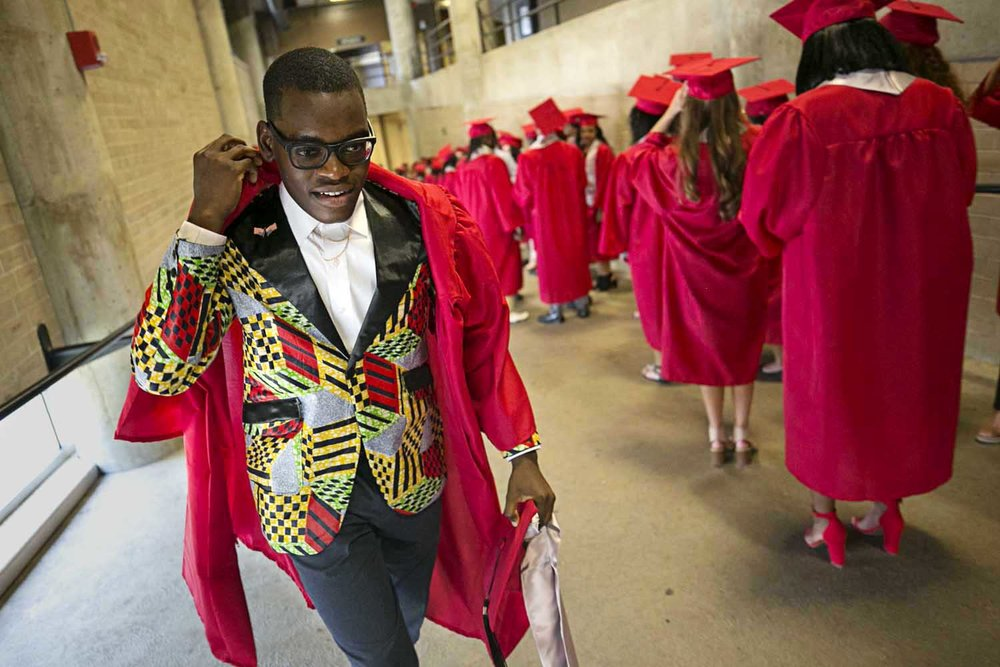 Benjamin Kalala walks up the ramp to his spot in line wearing sport coat made by his mother before the Springfield High School graduation at the Bank of Springfield Center Saturday June 3, 2017. [Photo by Jason Johnson]