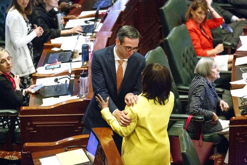 Rep. Will Guzzardi, D-Chicago, is congratulated by Rep. Mary Flowers, D-Chicago, after Guzzardi's bill to raise the minimum wage passed the House Tuesday, May 30, 2017 at the Capitol in Springfield, Ill. [Rich Saal/The State Journal-Register]