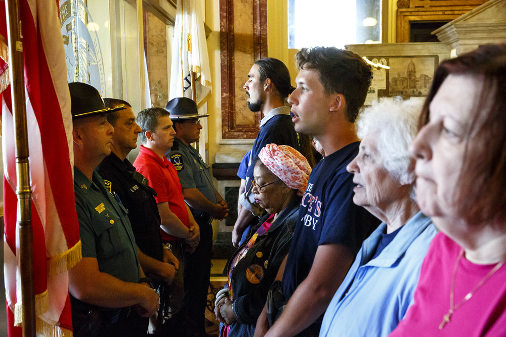 Activists pushing for plans to close so-called corporate tax loopholes and tax the wealthy at higher rates face off with Secretary of State Police at the entrance to the governor's office Tuesday, May 30, 2017 at the Capitol in Springfield, Ill. The protesters are part of a coalition called Fair Economy Illinois. Some members marched from Chicago to Springfield for the final days of the legislative session to urge lawmakers to pass a budget that helps working people. [Rich Saal/The State Journal-Register]