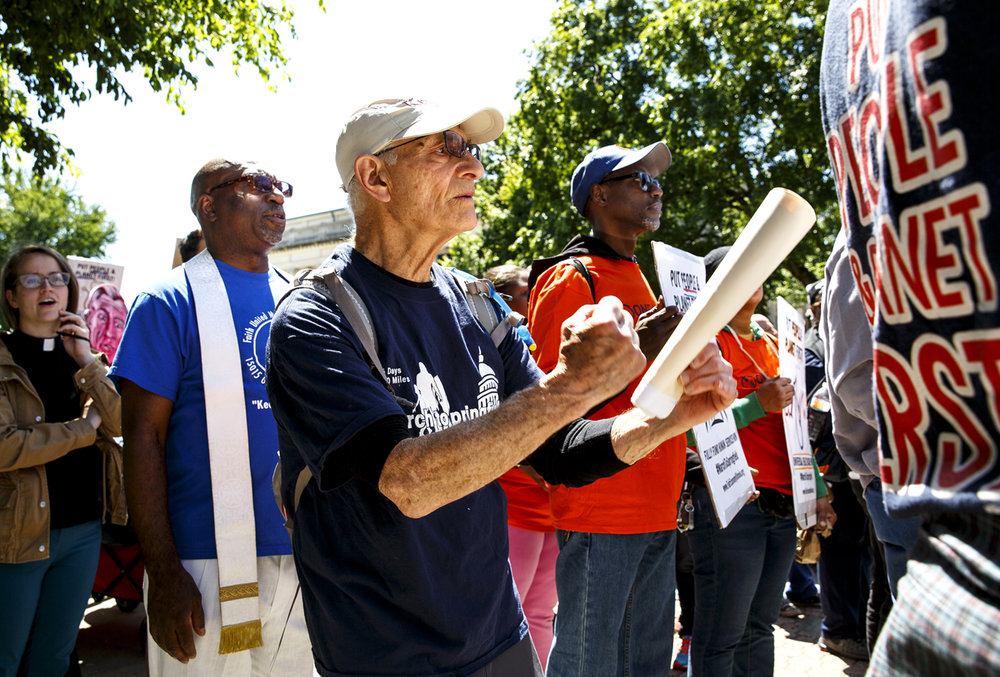 Dr. Alfred Klinger, a World War II veteran and participant in the March to Springfield protest and rallly, walks with other activists on the final leg of the march from the Old State Capitol to the Capitol Tuesday, May 30, 2017 in Springfield, Ill. Klinger participated in the march that began in Chicago on May 15, and urged lawmakers to pass a budget that helps working people.[Rich Saal/The State Journal-Register]