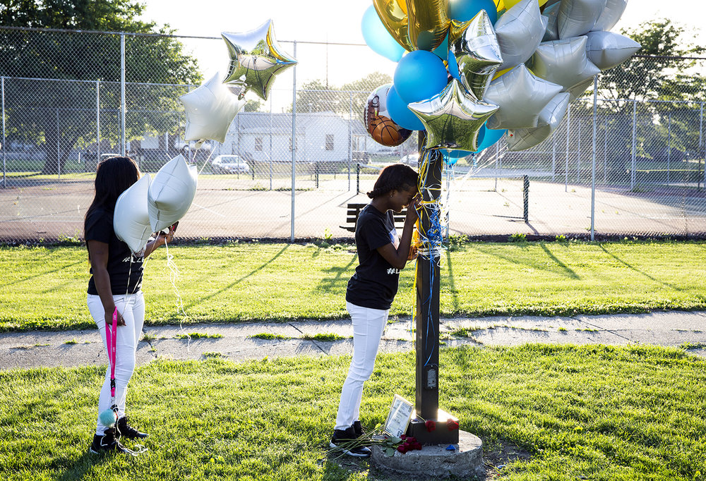 Karla Booker mourns her brother, Andre, before the start of a vigil for him at Comer Cox Park Thursday, June 1, 2017. Andre Booker was shot and killed at the park Wednesday. [Rich Saal/The State Journal-Register]