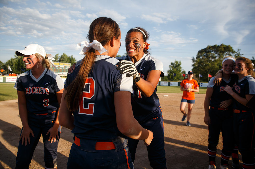 Rochester's Lyric Boone (14) celebrates with Rochester's Nicole Robinson (2) after the Rockets defeated Herrin 10-4 in the Class 3A Mattoon Supersectional at the Roundhouse Sports Complex, Monday, June 5, 2017, in Mattoon, Ill. [Justin L. Fowler/The State Journal-Register]