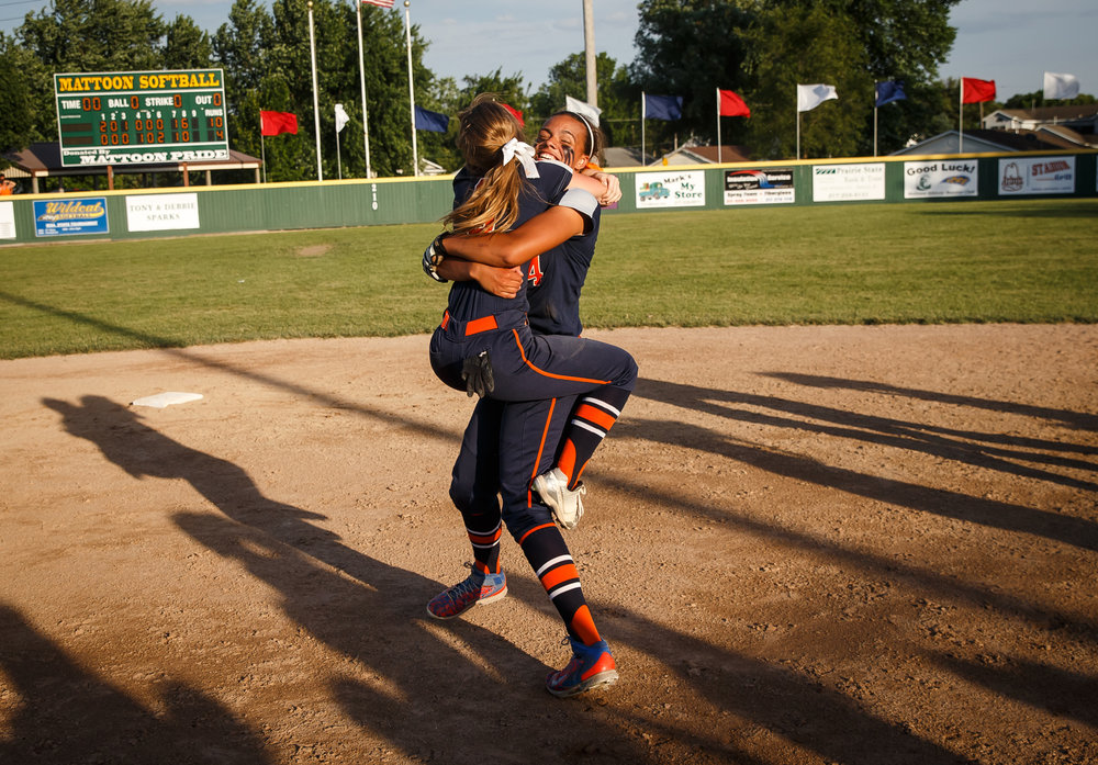 Rochester's Alanna Gillespie (8) leaps up into the arms of Rochester's Lyric Boone (14) after the Rockets defeated Herrin 10-4 in the Class 3A Mattoon Supersectional at the Roundhouse Sports Complex, Monday, June 5, 2017, in Mattoon, Ill. [Justin L. Fowler/The State Journal-Register]