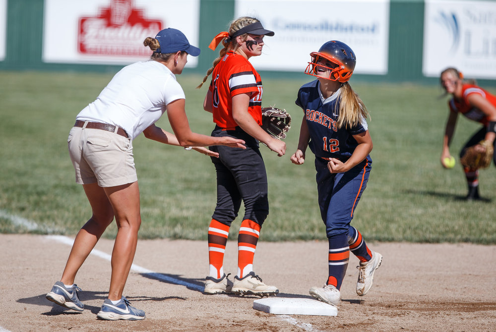 Rochester's Jillian Anderson (12) reacts after a two run triple in the first inning against Herrin during the Class 3A Mattoon Supersectional at the Roundhouse Sports Complex, Monday, June 5, 2017, in Mattoon, Ill. [Justin L. Fowler/The State Journal-Register]