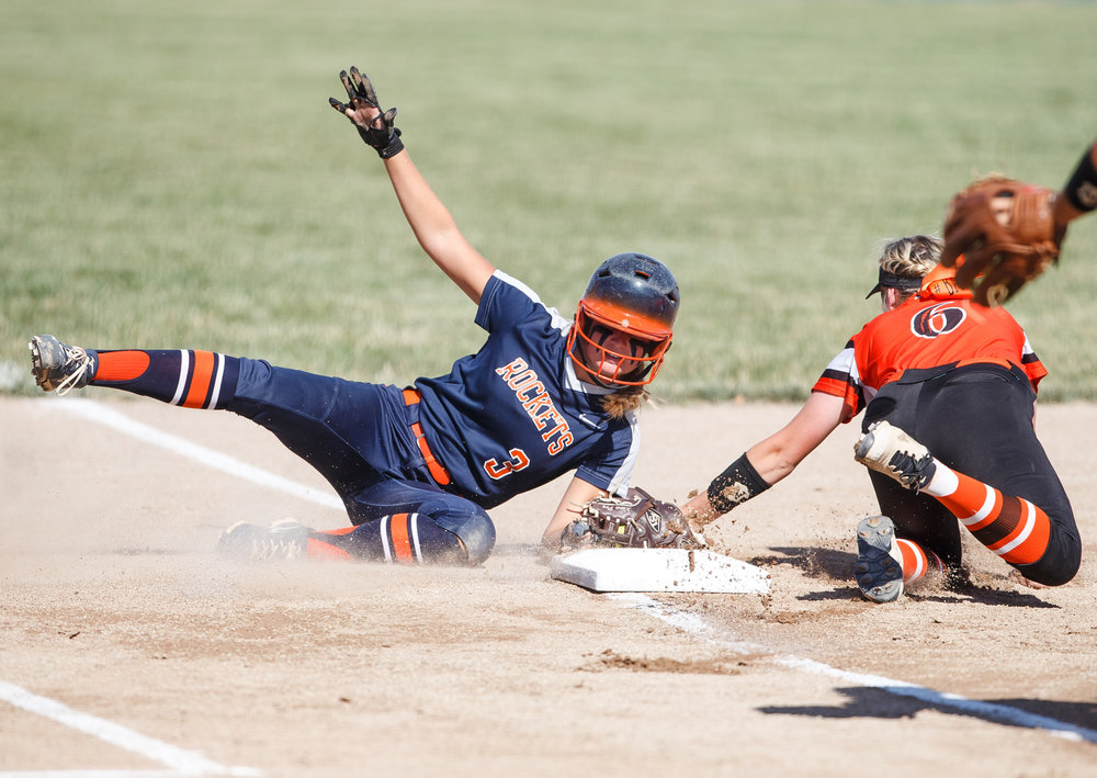 Rochester's Ali Bortmess (3) is safe at third as she beats the tag from Herrin's Raegen Gosha (6) in the first inning during the Class 3A Mattoon Supersectional at the Roundhouse Sports Complex, Monday, June 5, 2017, in Mattoon, Ill. [Justin L. Fowler/The State Journal-Register]