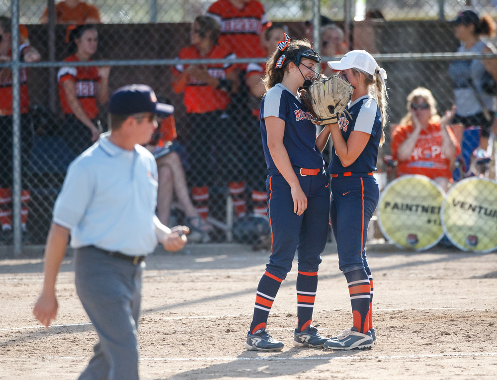 Rochester's Ali Bortmess (3) talks with Rochester's Reagan Miles (9) on the mound as the Rockets lead 3-1 against Herrin in the fourth inning during the Class 3A Mattoon Supersectional at the Roundhouse Sports Complex, Monday, June 5, 2017, in Mattoon, Ill. [Justin L. Fowler/The State Journal-Register]