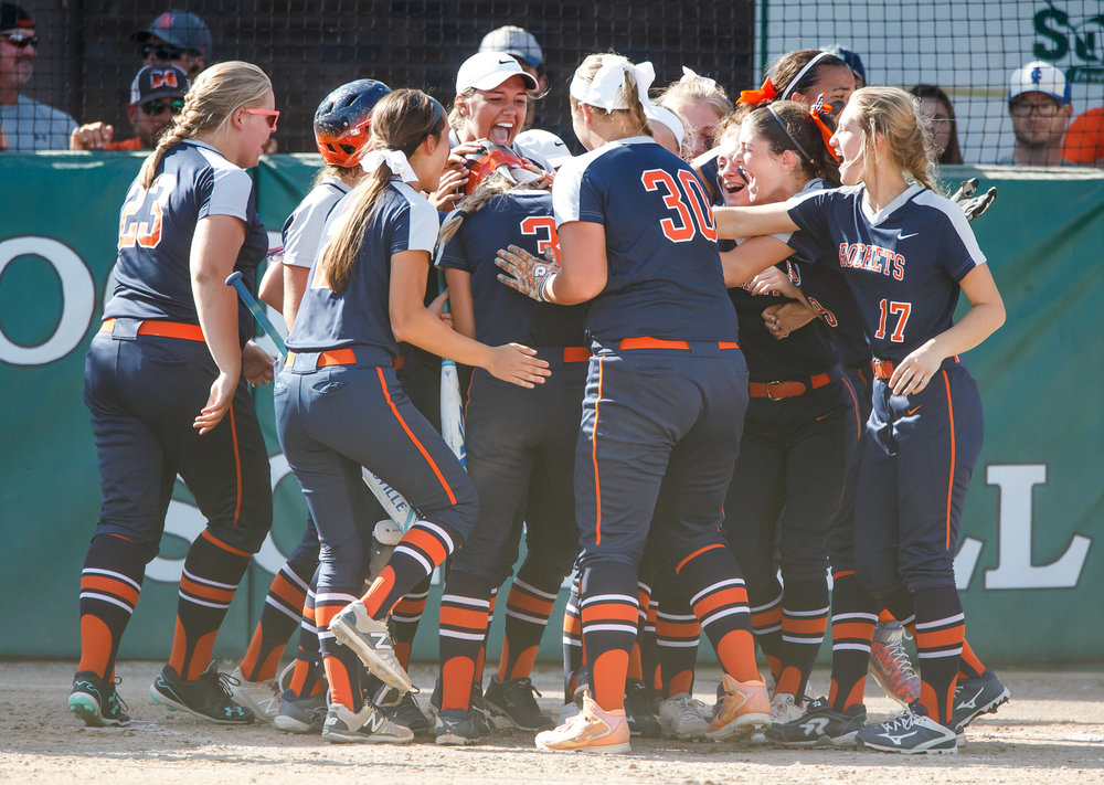 Rochester's Ali Bortmess (3) is swarmed by her teammates after a solo home run in the third inning to make it 3-0 Rockets against Herrin during the Class 3A Mattoon Supersectional at the Roundhouse Sports Complex, Monday, June 5, 2017, in Mattoon, Ill. [Justin L. Fowler/The State Journal-Register]