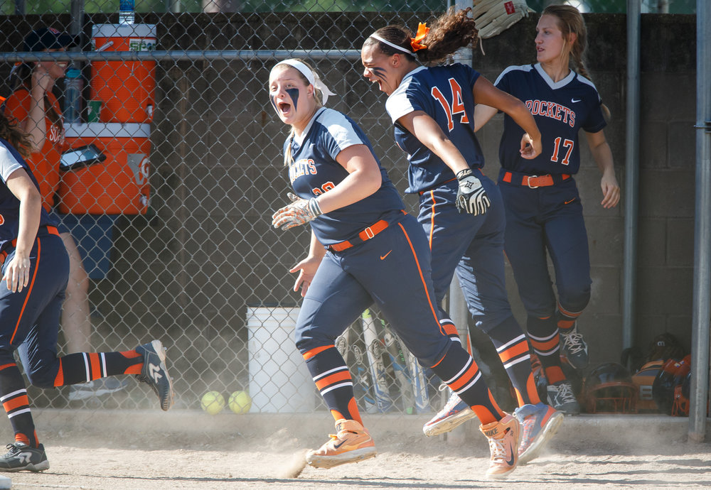 Rochester's Katie Nika (30) and Rochester's Lyric Boone (14) head to home plate with their teammates to congratulate Rochester's Ali Bortmess (3) on a solo home run in the third inning during the Class 3A Mattoon Supersectional at the Roundhouse Sports Complex, Monday, June 5, 2017, in Mattoon, Ill. [Justin L. Fowler/The State Journal-Register]
