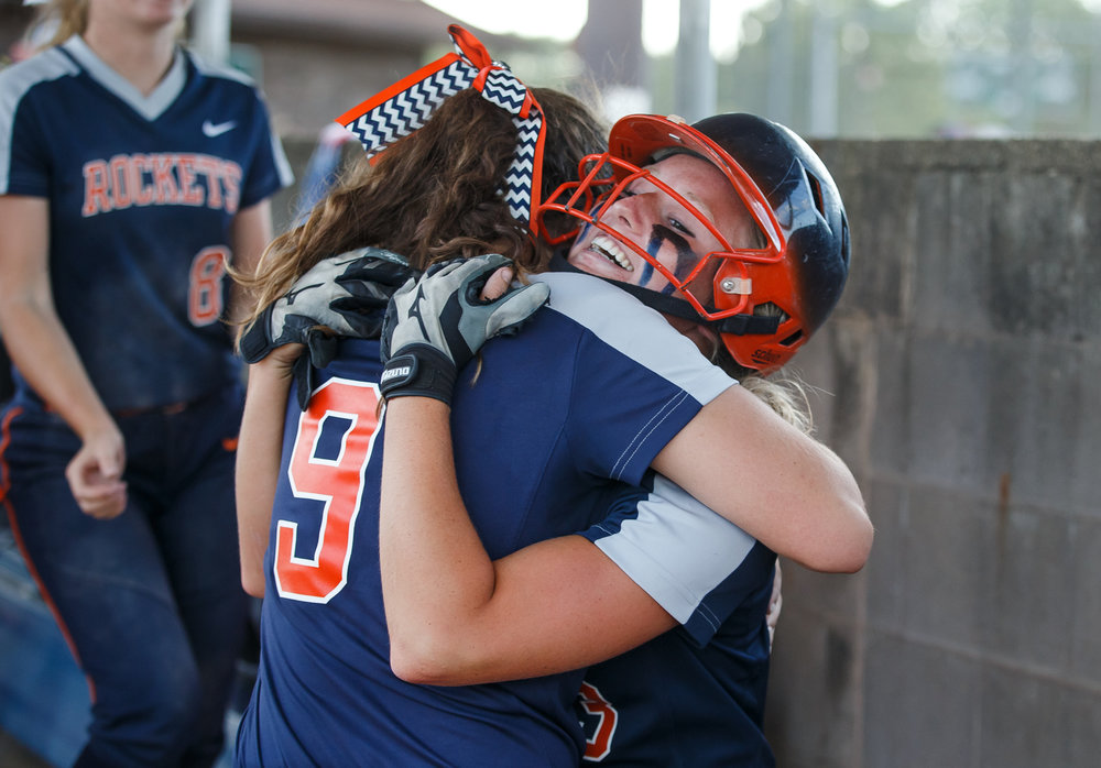 Rochester's Ali Bortmess (3) gets a hug from Rochester's Reagan Miles (9) after her solo home run in the eighth inning put the Rockets up 5-4 during the Class 3A Mattoon Supersectional at the Roundhouse Sports Complex, Monday, June 5, 2017, in Mattoon, Ill. [Justin L. Fowler/The State Journal-Register]