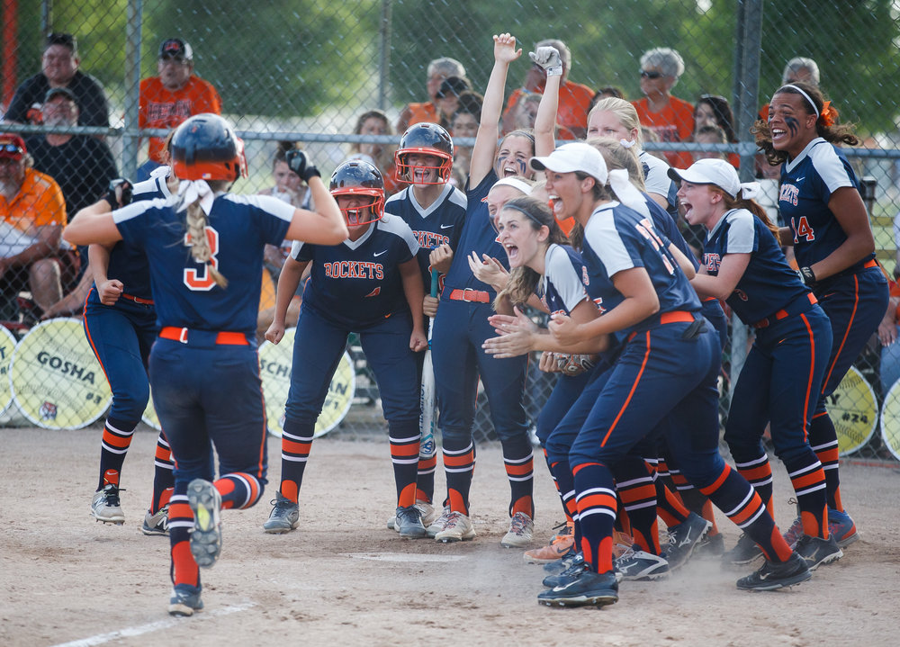 Rochester's Ali Bortmess (3) is welcomed to home plate after hitting a solo home run to put the Rockets up 5-4 in the eighth inning against Herrin during the Class 3A Mattoon Supersectional at the Roundhouse Sports Complex, Monday, June 5, 2017, in Mattoon, Ill. [Justin L. Fowler/The State Journal-Register]