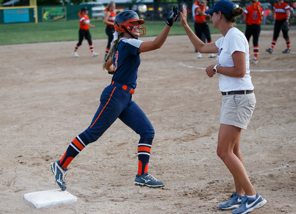 Rochester's Ali Bortmess (3) gets a high five from Rochester softball head coach Lindsay Howard after a solo home run to put the Rockets up 5-4 in the eighth inning against Herrin during the Class 3A Mattoon Supersectional at the Roundhouse Sports Complex, Monday, June 5, 2017, in Mattoon, Ill. [Justin L. Fowler/The State Journal-Register]