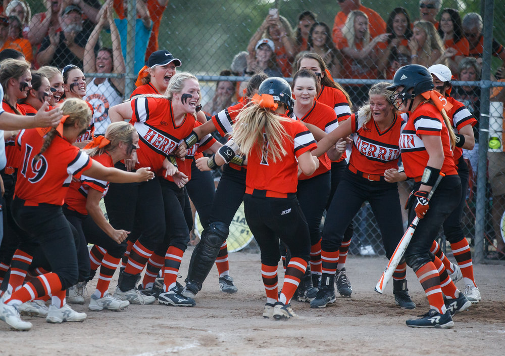 Herrin's Tori Schullian (1) is welcomed at home plate after hitting a home run to tie the game against Rochester in the seventh inning during the Class 3A Mattoon Supersectional at the Roundhouse Sports Complex, Monday, June 5, 2017, in Mattoon, Ill. [Justin L. Fowler/The State Journal-Register]