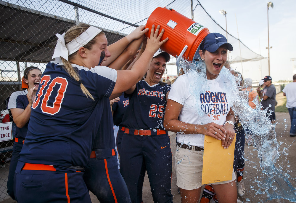 Rochester's Katie Nika (30) and Rochester's Abby Blatz (25) and the Rockets give Rochester softball head coach Lindsay Howard a Gatorade bath after they defeated Herrin 10-4 in the Class 3A Mattoon Supersectional at the Roundhouse Sports Complex, Monday, June 5, 2017, in Mattoon, Ill. [Justin L. Fowler/The State Journal-Register]